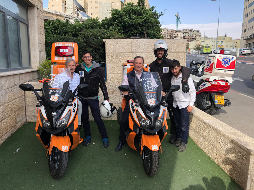 Miles Nadal (Center – Seated) on one of the ambucycles he donated to United Hatzalah of Israel
